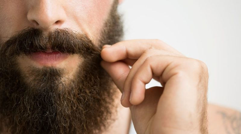 Man-stroking-beard